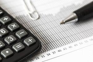 a calculator and balance sheet